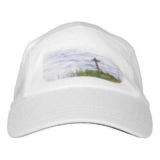 Cross by river hat