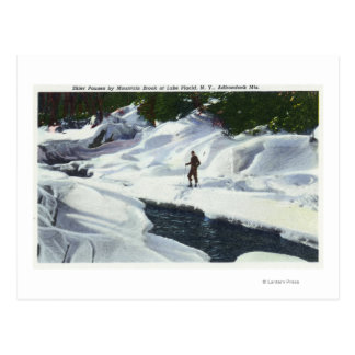 Cross-Country Skier Pauses by Mountain Brook Postcard