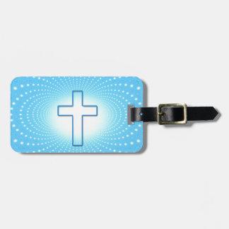 cross luggage tag