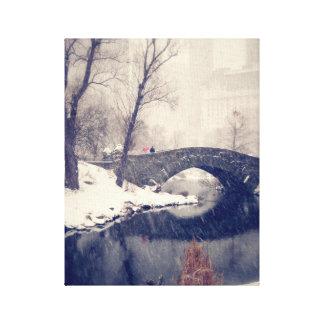 Crossing Bridges Through The Snow In Central Park Canvas Print