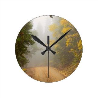 Cruising Into Autumn Fog Round Clock