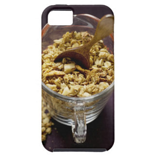 Crunchy muesli with wooden spoon in a measuring iPhone 5 cases