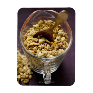 Crunchy muesli with wooden spoon in a measuring magnets