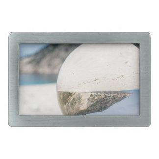Crystal ball on sandy greek beach belt buckle