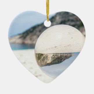 Crystal ball on sandy greek beach ceramic heart ornament