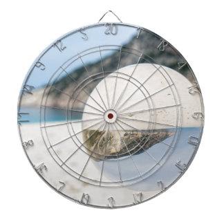 Crystal ball on sandy greek beach dart board