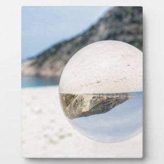 Crystal ball on sandy greek beach plaque