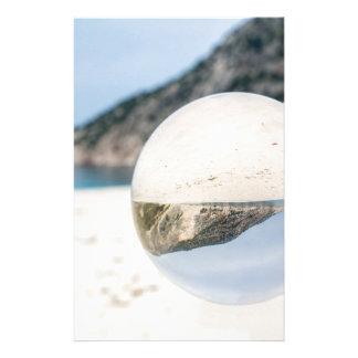 Crystal ball on sandy greek beach stationery