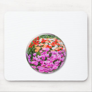 Crystal ball with various colored tulips on white mouse pad