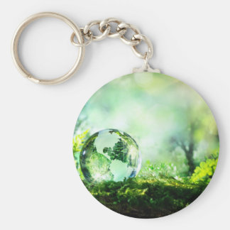 Crystal globe in a green forest basic round button keychain