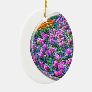 Crystal sphere with pink hyacinths on white ceramic oval ornament