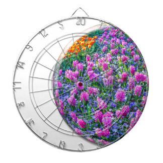 Crystal sphere with pink hyacinths on white dart boards