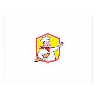 Cuisinier de chef tenant la bande dessinée de cartes postales