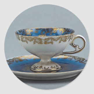 Cup and saucer with colorful designs round sticker