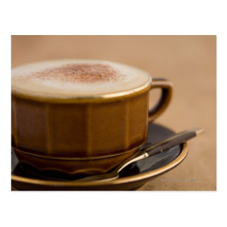 Cup of cappuccino with cocoa powder postcard