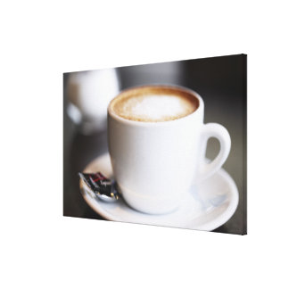 cup of coffee latte on table, close-up canvas print