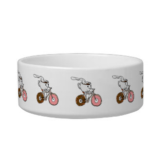Cup riding a bicycle with donut wheels bowl