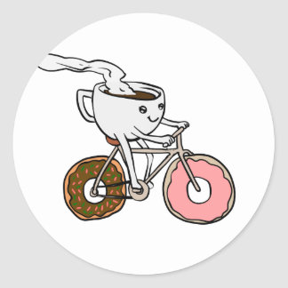 Cup riding a bicycle with donut wheels classic round sticker