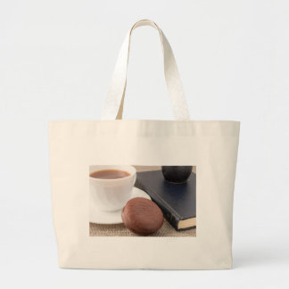 Cup with hot cocoa and chocolate cake large tote bag