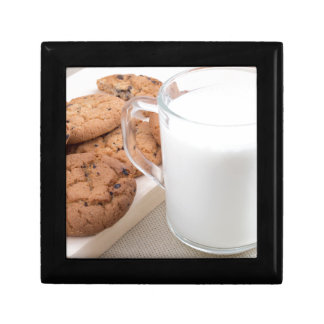 Cup with milk and oatmeal cookies gift box