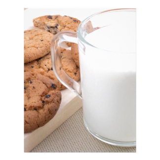 Cup with milk and oatmeal cookies letterhead