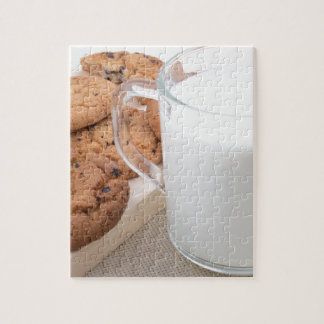 Cup with milk and oatmeal cookies puzzle