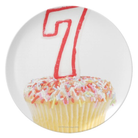 Cupcake with a numbered birthday candle 7 plate