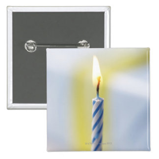 Cupcake with candle, close-up (focus on flame) 2 inch square button