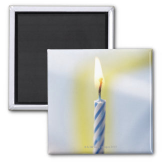 Cupcake with candle close-up focus on flame fridge magnet
