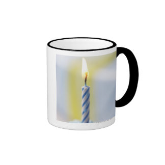 Cupcake with candle, close-up (focus on flame) coffee mugs