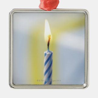 Cupcake with candle, close-up (focus on flame) Silver-Colored square ornament