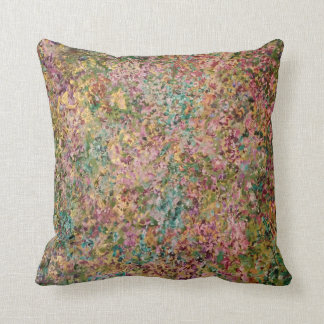 Cushion in turquoise, pink and gold.