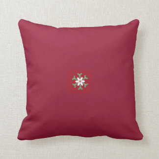 Cushion with small poinsettia motif for new home