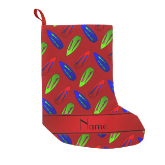 Custom name red green blue surfboards on red small christmas stocking