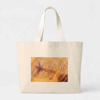 Cut down a tree with annual rings large tote bag
