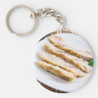 Cut the fillet pieces baked chicken on a plate basic round button keychain