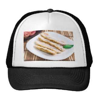 Cut the fillet pieces baked chicken on a plate trucker hat