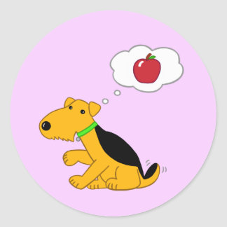 Cute Airedale Dog Thinks About an Apple Sticker