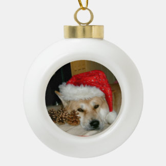 Cute akita in red santa hat with christmas cones ceramic ball christmas ornament