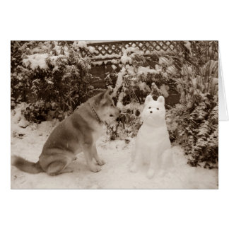 cute akita sitting in snow with snowman dog photo card
