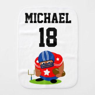 Cute American football player holding a football, Burp Cloth