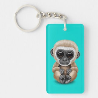 Cute and Curious Baby Gibbon on Blue Keychain
