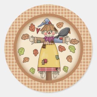 Cute Autumn Scarecrow on Plaid Pattern Background Round Sticker