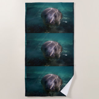 Cute baby manatee beach towel