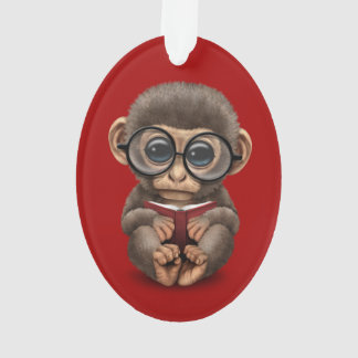 Cute Baby Monkey Reading a Book on Red Ornament