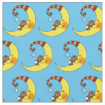 cute baby sleeping on yellow moon nursery fabric