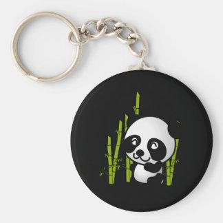 Cute black and white panda bear in a bamboo grove. keychain