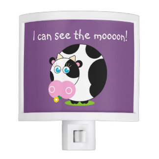 Cute cartoon black and white cow eating a flower, night light