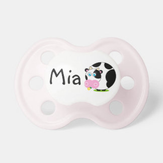 Cute cartoon black and white cow eating a flower, pacifier