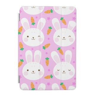 Cute cartoon bunnies and carrots on pink pattern iPad mini cover